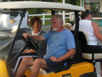 Marlene and Pete test driving her new cart